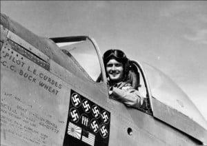"Pilot Lt. Louis Curdes in his P-51 Mustang ""Bad Angel""."
