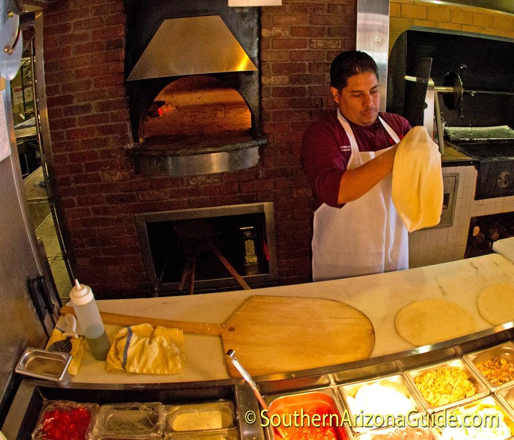 Chef Edwardo at Tavolino Ristorante Italiano preparing our three pizzas.