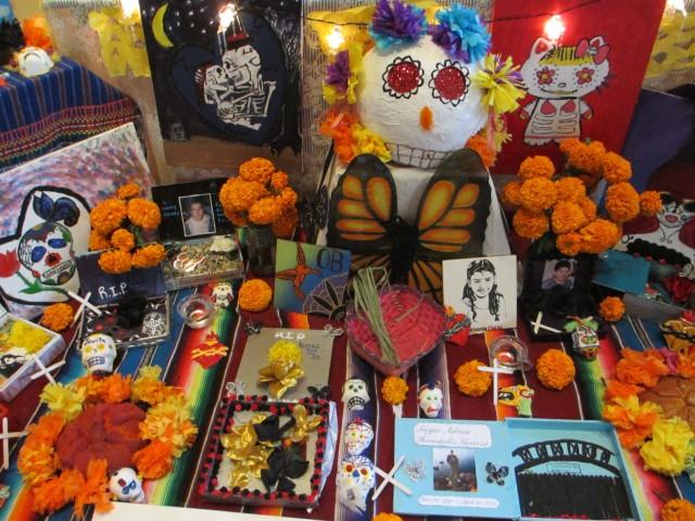 A Dia de los Muertos alter at the Art Museum decorated by Tucson school children.